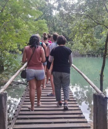 Volunteers walking over bridge on Palawan island